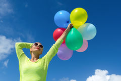 Woman holding balloons against  sky. Woman holding balloons against cloud and sky Royalty Free Stock Photography
