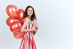 Woman holding balloons, blank space for copy, holiday.  Stock Photo