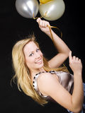 Woman holding balloons and celebrating. Smiling woman holding balloons and celebrating Royalty Free Stock Photos