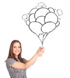 Woman holding balloons drawing. Happy young woman holding balloons drawing Stock Photos