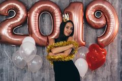 Woman holding balloons looking at camera. Celebration holiday new year stock photos