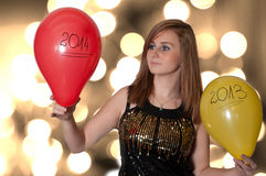 Woman holding a balloons on new year Stock Photo