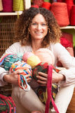 Woman Holding Balls Of Wool In Front Of Yarn Stock Images