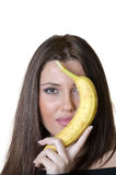 Woman holding a banana hiding her half face Stock Photos