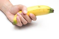Woman holding banana. On whitebackground Stock Photography