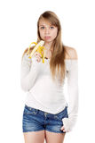Woman holding banana Stock Images