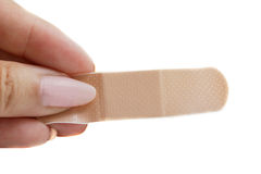 Woman holding a band-aid Stock Photography