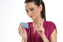 Woman holding a  bank or credit card. Beautiful woman holding a membership card, bank or credit card, business card Stock Photography