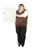Woman holding a banner. Isolated full length studio shot of large woman holding a banner Stock Photo