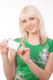 Woman holding a banner. Young blonde woman holding a banner Royalty Free Stock Image