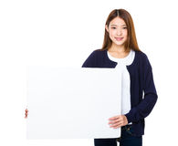 Woman holding a banner ad Stock Photo