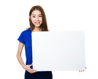 Woman holding a banner ad. Isolated on white background Royalty Free Stock Photography