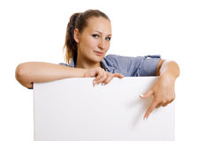 Woman holding a banner ad. Young woman points a finger at blank banner Stock Photos