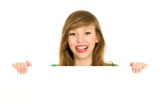 Woman holding banner add. Beautiful young woman holding blank placard Stock Photography