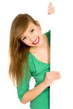 Woman holding banner add. Beautiful young woman holding blank placard Stock Image