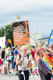 Woman holding banner in the crowd during Stockholm Pride Parade Royalty Free Stock Photography