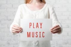 Woman holding banner of play  passion leisure activity Royalty Free Stock Photo