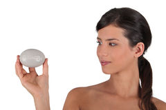 Woman holding a bar of soap Stock Photos