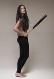 Woman holding baseball bat Stock Photos