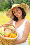 Woman holding a basket Royalty Free Stock Photos