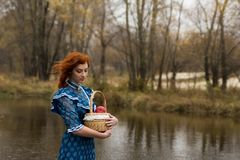 Woman holding  basket with apples in autumn outdoor Royalty Free Stock Photo
