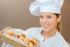 Woman holding basket choux pastry Royalty Free Stock Photo