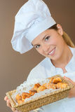 Woman holding basket choux pastry Royalty Free Stock Image