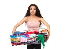 Woman holding basket of clothes Stock Photos