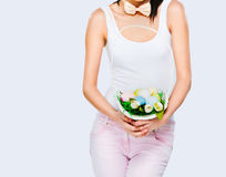 Woman holding a basket with Easter eggs Stock Photo