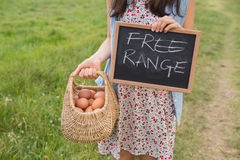 Woman holding basket of free range eggs Royalty Free Stock Photos