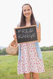 Woman holding basket of free range eggs Royalty Free Stock Images