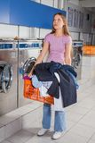 Woman Holding Basket Full Of Dirty Clothes Stock Image