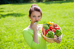 Woman holding a basket full of healthy food Royalty Free Stock Images