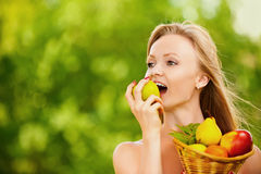 Woman Holding Basket Full Of Fruits Stock Image