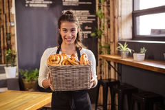 Woman holding a basket with pastries inside Royalty Free Stock Photos