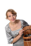 Woman holding a basket Royalty Free Stock Image