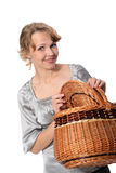 Woman holding a basket and smiling Stock Photo