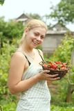 Woman holding basket with strawberries Stock Photography