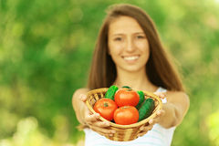 Woman holding basket of tomatoes Royalty Free Stock Photos