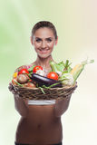 Woman holding basket with vegetable royalty free stock images