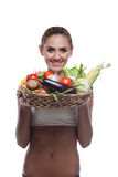 Woman holding basket with vegetable Stock Photography