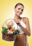 Woman holding basket with vegetable. Concept vegetar Royalty Free Stock Image