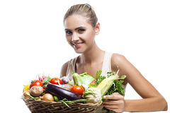 Woman holding basket with vegetable. On white background Stock Photos