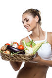 Woman holding basket with vegetable Stock Photo