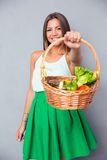 Woman holding basket with vegetables Royalty Free Stock Photos