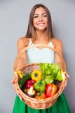Woman holding basket with vegetables Royalty Free Stock Photography