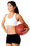 Woman holding a basketball Stock Photo