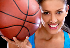 Woman holding basketball Stock Images