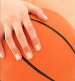 Woman holding Basketball royalty free stock photos