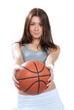 Woman holding Basketball ball in hands and give it Royalty Free Stock Photo